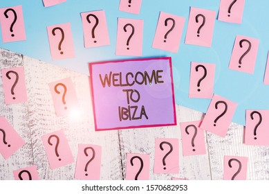Handwriting text Welcome To Ibiza. Concept meaning Warm greetings from one of Balearic Islands of Spain Scribbled and crumbling papers with thick cardboard above wooden table.