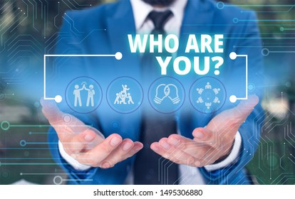 Handwriting text Who Are You question. Concept meaning asking demonstrating identity or demonstration information Male human wear formal work suit presenting presentation using smart device.
