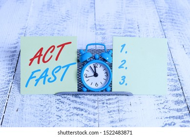 Handwriting text writing Act Fast. Concept meaning Voluntarily move in the highest state of speed initiatively.