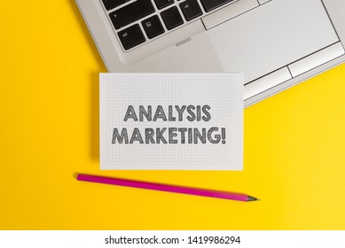 Handwriting text writing Analysis Marketing. Concept meaning Quantitative and qualitative assessment of a market Top trendy metallic laptop pencil squared paper sheet colored background.