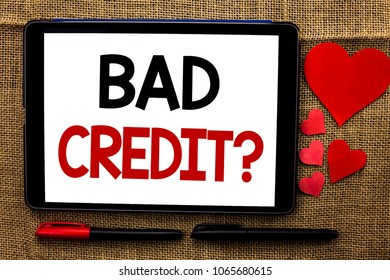 Handwriting text writing Bad Credit Question. Concept meaning Low Credit Finance Economic Budget Asking Questionaire written on Tablet on the jute background Hearts and Pens next to it.