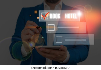 Handwriting text writing Book Hotel. Concept meaning an arrangement you make to have a hotel room or accommodation.