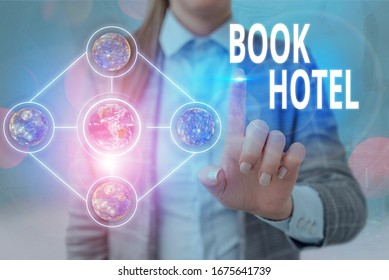 Handwriting text writing Book Hotel. Concept meaning an arrangement you make to have a hotel room or accommodation Elements of this image furnished by NASA.