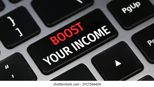 Handwriting text writing Boost Your Income. Concept meaning increase month or annual salary using part time job Keyboard key Intention to create computer message pressing keypad idea.