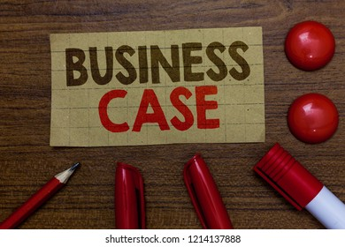 Handwriting text writing Business Case. Concept meaning Proposition Undertaking Verbal Presentation New Task Paperboard markers pencil wooden background communicating ideas red balls.