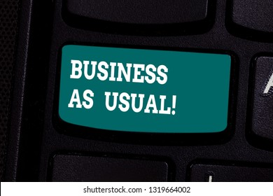 Handwriting text writing Business As Usual. Concept meaning ongoing and unchanging state affairs despite difficulties Keyboard key Intention to create computer message pressing keypad idea.