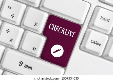 Handwriting text writing Checklist. Concept meaning List down of the detailed activity as guide of doing something White pc keyboard with empty note paper above white background key copy space.