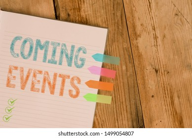 Handwriting text writing Coming Events. Concept meaning Happening soon Forthcoming Planned meet Upcoming In the Future Striped note book four colored arrow banners reminder wooden background.