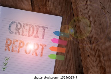 Handwriting text writing Credit Report. Concept meaning Borrowing Rap Sheet Bill and Dues Payment Score Debt History Striped note book four colored arrow banners reminder wooden background.