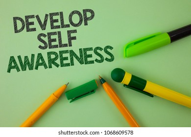 Handwriting text writing Develop Self Awareness. Concept meaning What you think you become motivate and grow written Plain Green background Pens next to it.