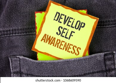 Handwriting text writing Develop Self Awareness. Concept meaning What you think you become motivate and grow written Sticky Note Paper placed the Jeans background.