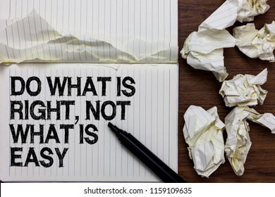 Handwriting text writing Do What Is Right, Not What Is Easy. Concept meaning Make correct actions Have integrity Marker over notebook crumpled papers ripped pages several tries mistakes.
