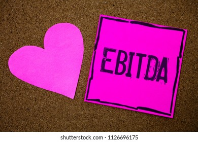 Handwriting text writing Ebitda. Concept meaning Earnings Before Interest Taxes Depreciation Amortization Abbreviation Cork background pink paper papers ideas messages heart love lovely inspire.