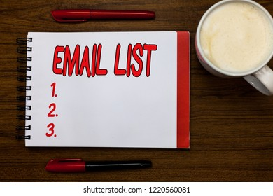 Handwriting text writing Email List. Concept meaning Contacts information to send electronic correspondence newsletter Open notebook markers inspiration communicate ideas wooden table cup coffee.