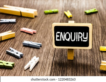 Handwriting text writing Enquiry. Concept meaning Asking for information Official investigation discover facts Inquiry Blackboard standing several clothespins disorganized messy wooden floor.