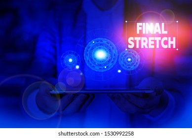 Handwriting text writing Final Stretch. Concept meaning Last Leg Concluding Round Ultimate Stage Finale Year ender Woman wear formal work suit presenting presentation using smart device.