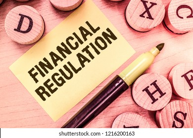 Handwriting text writing Financial Regulation. Concept meaning aim to Maintain the integrity of Finance System