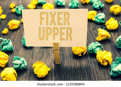 Handwriting text writing Fixer Upper. Concept meaning house in need of repairs used chiefly connection with purchase Clothespin holding light pink note paper crumpled papers several tries.