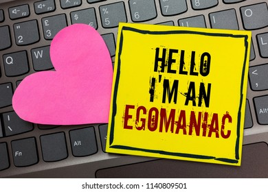 Handwriting text writing Hello I am An Egomaniac. Concept meaning Selfish Egocentric Narcissist Self-centered Ego Written on black bordered yellow page touched pink heart on computer keyboard.