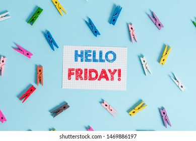Handwriting text writing Hello Friday. Concept meaning you say this for wishing and hoping another good lovely week Colored clothespin rectangle shaped reminder paper light blue background.