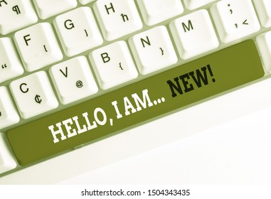 Handwriting text writing Hello I Am New. Concept meaning used greeting or begin telephone conversation White pc keyboard with empty note paper above white background key copy space.
