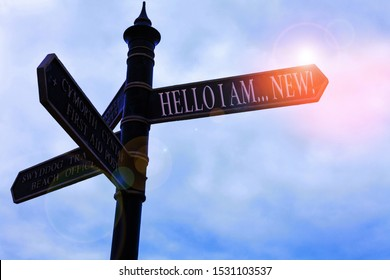 Handwriting text writing Hello I Am New. Concept meaning used as greeting or to begin telephone conversation Road sign on the crossroads with blue cloudy sky in the background.