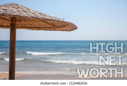 Handwriting text writing High Net Worth. Concept meaning having high-value Something expensive A-class company Blue beach water Thatched Straw Umbrellas Message Ideas Thoughts Reflection.