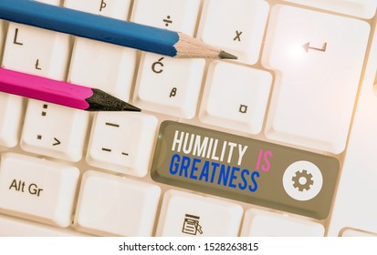 Handwriting text writing Humility Is Greatness. Concept meaning being Humble is a Virtue not to Feel overly Superior White pc keyboard with empty note paper above white background key copy space.