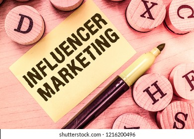 Handwriting text writing Influencer Marketing. Concept meaning Endorser who Influence Potential Target Customers