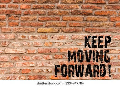 Handwriting text writing Keep Moving Forward. Concept meaning Optimism Progress Persevere Move Brick Wall art like Graffiti motivational call written on the wall.