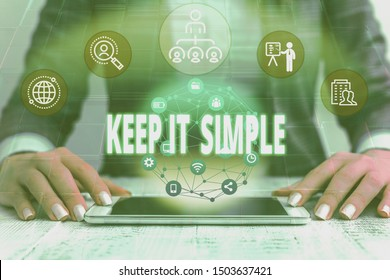 Handwriting text writing Keep It Simple. Concept meaning to make something easy to understand and not in fancy way Female human wear formal work suit presenting presentation use smart device.