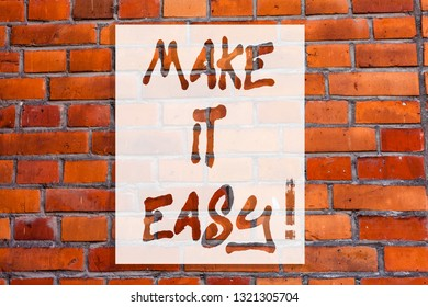 Handwriting text writing Make It Easy. Concept meaning Smart approach Effortless Free from worries or difficulties Brick Wall art like Graffiti motivational call written on the wall.