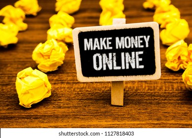 Handwriting text writing Make Money Online. Concept meaning Business Ecommerce Ebusiness Innovation Web Technology White text black paint wooden board clip desk yellow paper notes warning.