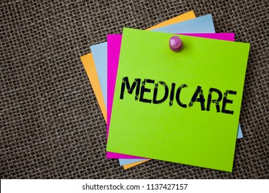 Handwriting text writing Medicare. Concept meaning Federal health insurance for people above 65 or with disabilities Sticky cards board pinned muliple colours remember idea jute background.