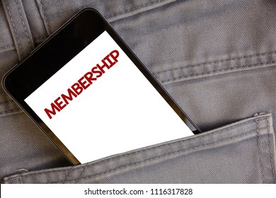 Handwriting text writing Membership. Concept meaning Being member Part of a group or team Join an organizationConcept on cell phone into jean pocket white screen black and red letters.