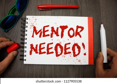 Handwriting text writing Mentor Needed Motivational Call. Concept meaning Guidance advice support training required Googles glasses pen marker cap notepad notebook highlighter eye sight.