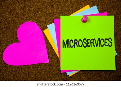 Handwriting text writing Microservices. Concept meaning Software development technique Decomposing an application Thumb pinned sticky cards love heart messages card remember sign board.