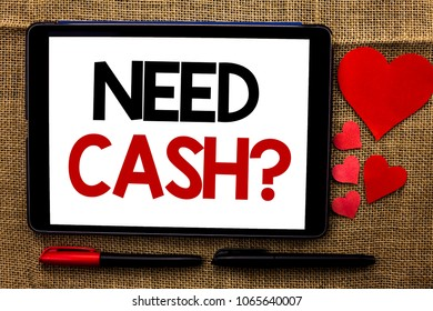 Handwriting text writing Need Cash Question. Concept meaning Wealth Question Needy Currency Money Advice Conceptual written on Tablet on the jute background Hearts and Pens next to it.