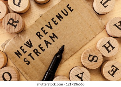 Handwriting text writing New Revenue Stream. Concept meaning Additional Enhanced Source of Income Improved Approach