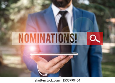 Handwriting text writing Nominations. Concept meaning action of nominating or state being nominated for prize Businessman in blue suite with a tie holds lap top in hands.