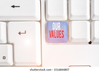 Handwriting text writing Our Values. Concept meaning list of morals companies or individuals commit to do them White pc keyboard with empty note paper above white background key copy space.