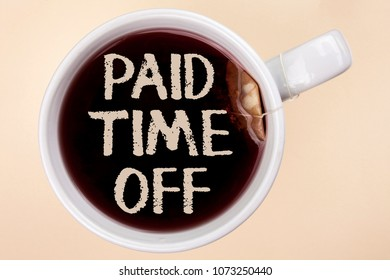 Handwriting text writing Paid Time Off. Concept meaning vacation with full payment take vacation Resting Healing written on Tea in a Cup on the plain background Tea Bag.