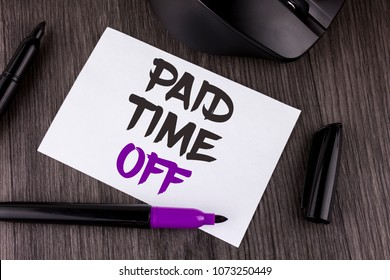 Handwriting text writing Paid Time Off. Concept meaning vacation with full payment take vacation Resting Healing written on White Sticky Note Paper on the wooden background Mouse Markers