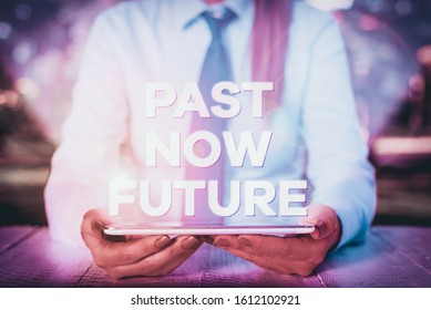 Handwriting text writing Past Now Future. Concept meaning Last time Present Following actions Destiny Memories Female business person sitting by table and holding mobile phone.