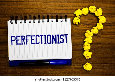 Handwriting text writing Perfectionist. Concept meaning Person who wants everything to be perfect Highest standards Study notebook register ink pen question mark answer session brown table.