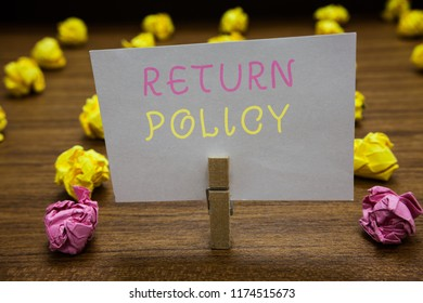 Handwriting text writing Return Policy. Concept meaning Tax Reimbursement Retail Terms and Conditions on Purchase Clothespin holding white paper note crumpled papers several tries mistakes.