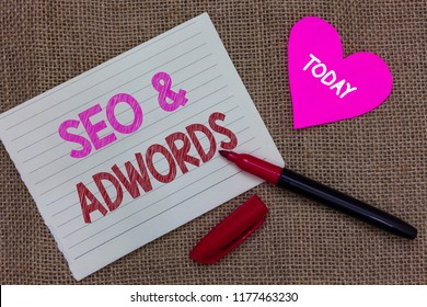 Handwriting text writing Seo and Adwords. Concept meaning Pay per click Digital marketing Google Adsense Piece notebook paper heart jute background open marker Communicating ideas.