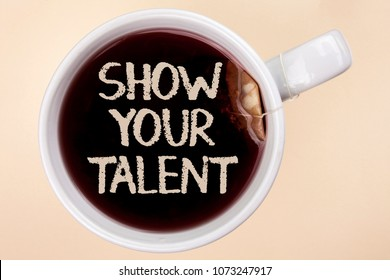 Handwriting text writing Show Your Talent. Concept meaning Demonstrate personal skills abilities knowledge aptitudes written on Tea in a Cup on the plain background Tea Bag.