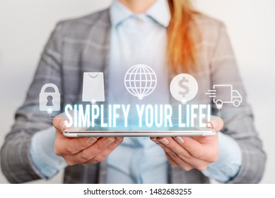 Handwriting text writing Simplify Your Life. Concept meaning focused on important and let someone else worry about less ones Modern technology tech loock Lady front presenting hands blue glow copy