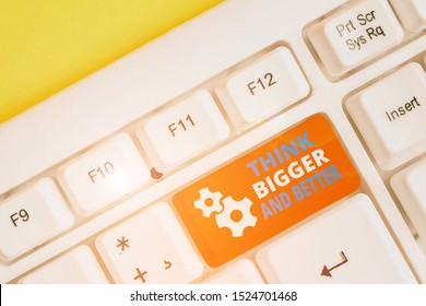 Handwriting text writing Think Bigger And Better. Concept meaning no Limits be Open minded Positivity Big Picture White pc keyboard with empty note paper above white background key copy space.